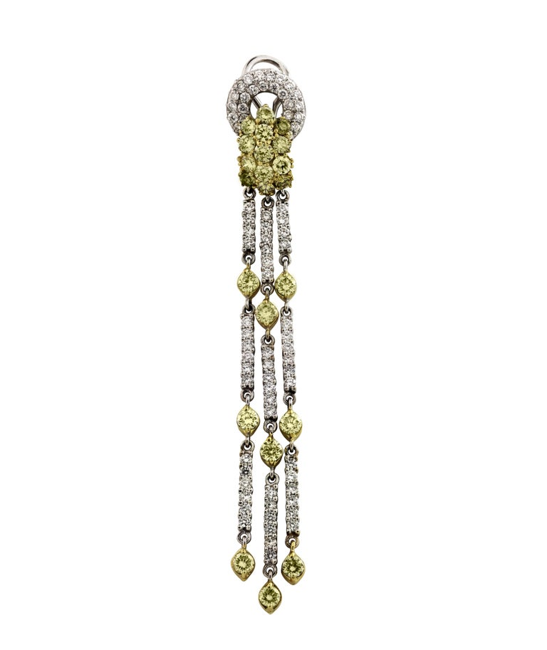 18K Green Yellow and White Two-Tone Gold Gold Chandelier Earrings with Yellow and White Diamonds   4.12 carat G color, VS clarity white diamonds  5.20 carat Green/Yellow Diamonds. Diamonds are 9.32 carat total weight  These stunning chandelier