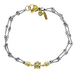 Two-Tone Yellow White Gold and Diamond Chain Bracelet with Flower Cluster