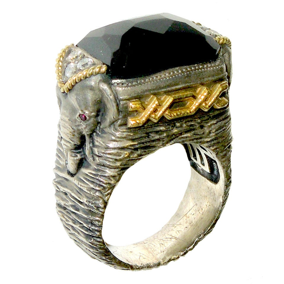 silver and gold elephant ring with black onyx center