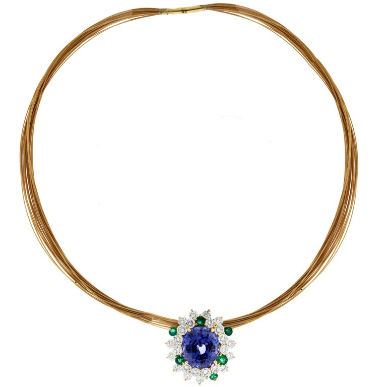 IF YOU ARE REALLY INTERESTED, CONTACT US WITH ANY REASONABLE OFFER. WE WILL TRY OUR BEST TO MAKE YOU HAPPY!  18K Yellow Gold and White Diamond Pendant Multi-Strand Necklace with Green and Oval Cut Blue Sapphire:  23.26 carat Violet-Blue Oval Cut