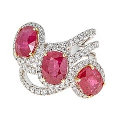 7.87 Carat Oval Ruby with 1.62 Carat of Diamond White and Yellow Gold Ring