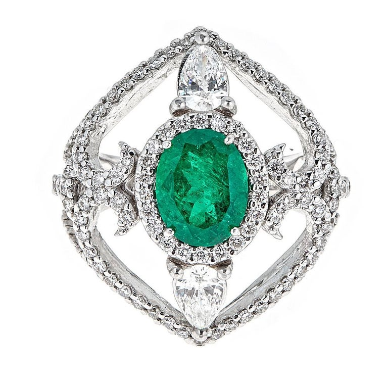 1.66 Carat Oval Emerald and 1.72 Carat Diamond White Gold Cocktail Ring For Sale