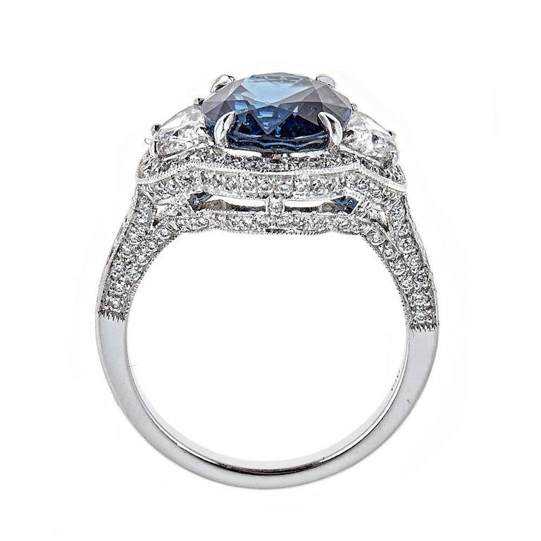 Oval Cut 5.22 Carat Blue Sapphire and Half Moon Diamond White Gold Ring For Sale