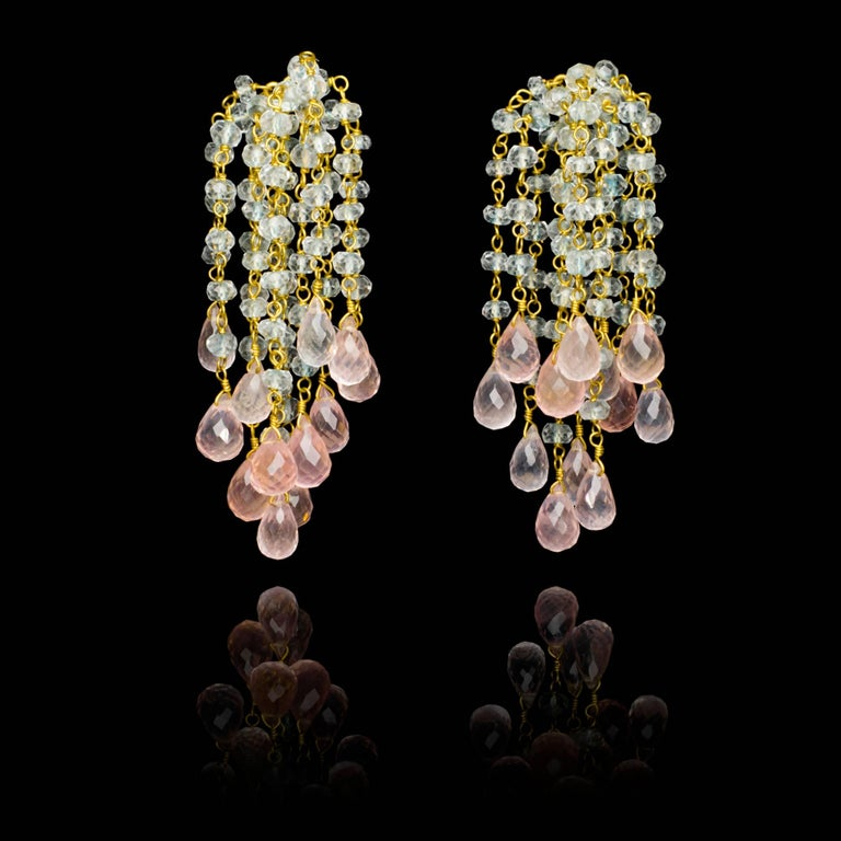A pair of hand crafted 18 karat gold Waterfall earrings with light blue faceted aquamarine beads and delicate rose quartz briolettes.  Due to the hand made nature of each piece of jewellery, some very slight variation may occur compared with the