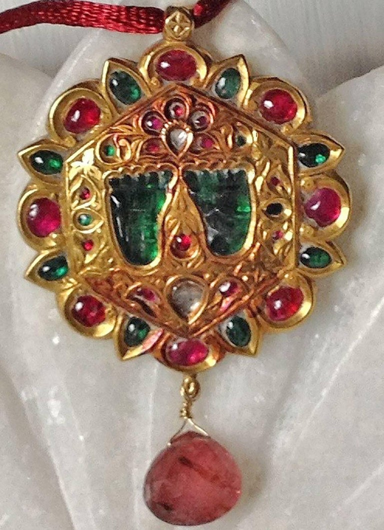A charming hand made pendant created using traditional Rajasthani techniques. Flat cut foiled backed diamonds, natural rubies. The green stones are probably quartz which have been backed with green foil. The pendant features a delightful pair of