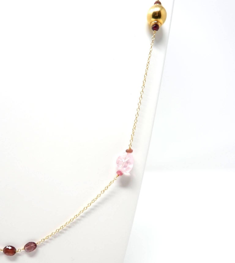 An elegant 18 karat gold, hand crafted gold necklace with tumbled light pink Morganite and faceted oval rubellite beads. The gold beads have been hand crafted in India. Morganite belongs to the sought after beryl family of gems which also includes