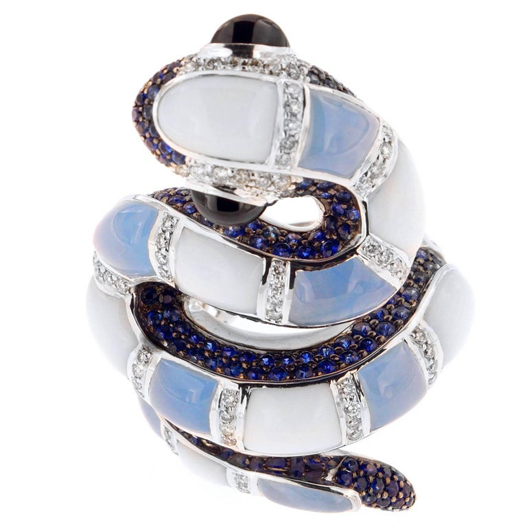 Ready to strike at a moment's notice is the stunningly detailed Pastel Python ring, a Zorab Creation.  Wrapping its way around your finger, marblelized sections of German-treated blue jade 7.24 carats and white chalcedony 7.24 carats intersect with