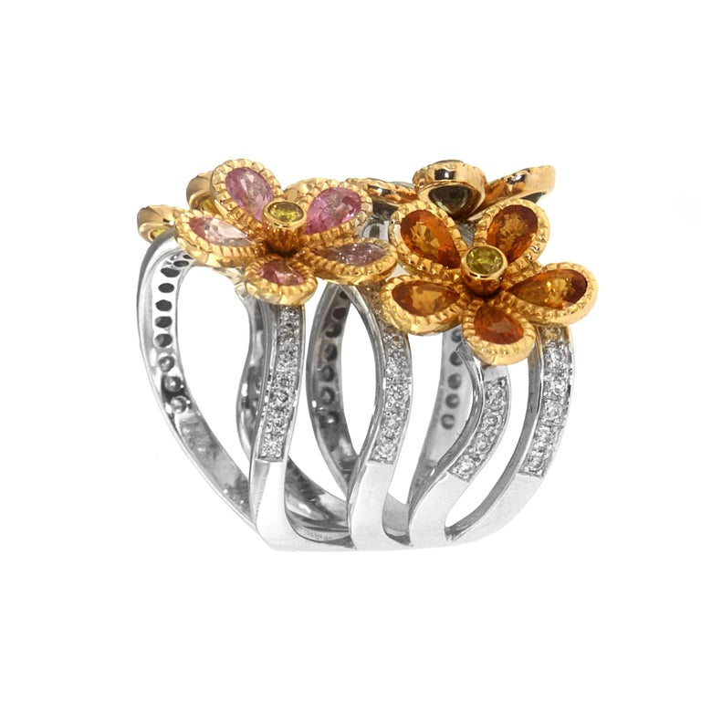 Zorab captures nature with its most delicate delight - blooming flowers created with 2.31 Carats of Green Sapphire, 2.00 Carats of Orange Sapphire, and 2.01 Carats of Pink Sapphire. The twinkling bouquet is set with 0.77 Carats of White Diamonds and