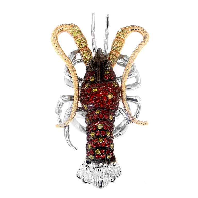 From the deepest of fantasy oceans emerge a true treasure. 2.79 carats of fiery sapphires and 0.95 carats of yellow diamonds accented by 0.03 carats of white diamonds set in 18-karat gold and palladium, resulting is one supremely creative
