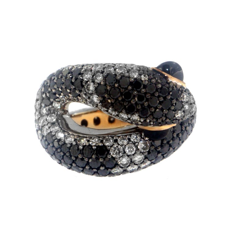 While most snakes carry a deadly bite, the Sweet Venom ring, a Zorab Creation, was designed to deliver a much more seductive lure.  3.30 carats of black diamonds blend with 4.07 carats of white diamonds set with 0.72 carats of spinel, all scaled to