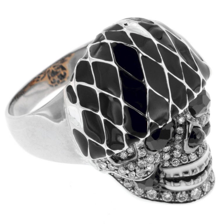 From 2019's Moschino Resort to Gucci, the whimsical black and white Harlequin pattern is becoming all the rage for women and men in ready-to-wear and accessories.  The Harlequin Skull ring, a Zorab Creation is right in step and running off the