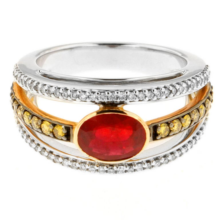 Say hello to the New Classic! Zorab's halo style ring features a 1.78 Carat Ruby Center Stone with 0.38 Carats of White Diamonds and 0.40 Carats of yellow Diamonds emphasizing the fiery glow of the Ruby.   This item has a serial number and bears the