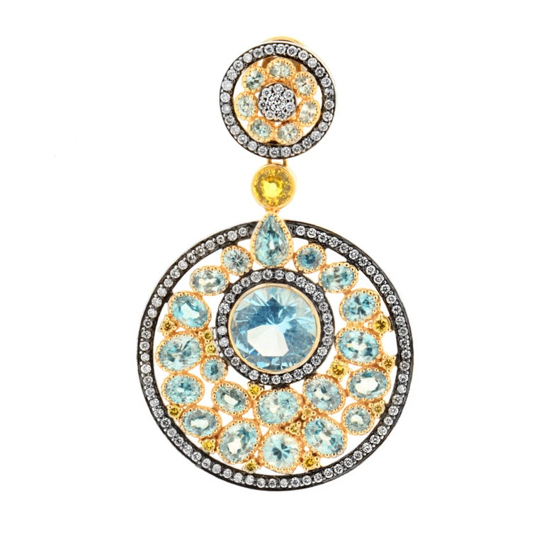 Inspired by ancient Native American origins, the Dreamcatcher earring by Zorab Creation is as complex and structured as it is alluring.   For this meticulous design, 18k Gold and Palladium embrace brilliant sky blue topaz gemstones, 10.75 Carats.