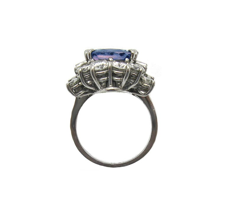 This creative sapphire and diamond piece will serve you two ways: as a ring or a pendant! Featuring a 6.57ct cushion cut Sapphire, un-heated and GIA certified. The center sapphire is framed by 16 baguette and round diamonds totaling over 3.20ct,