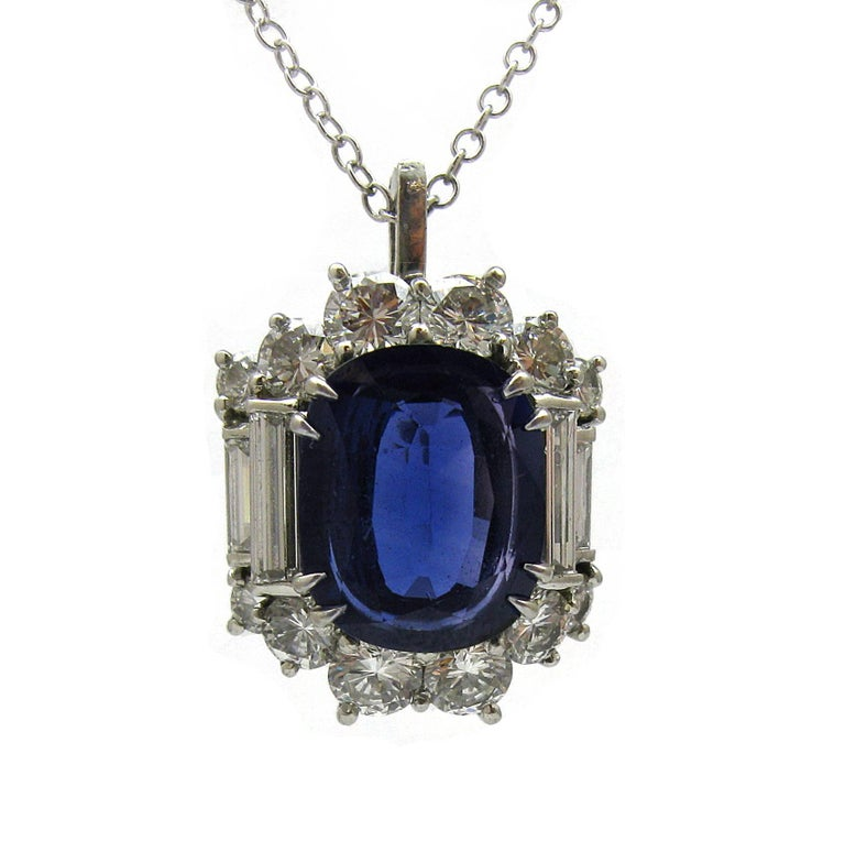 Cushion Cut 6.57 Carat GIA Certified Un-Heated Blue Sapphire and Diamond Ring in Platinum For Sale