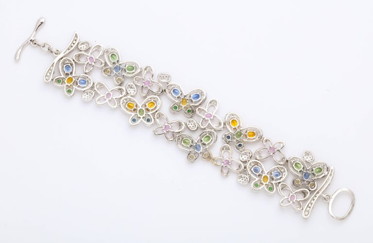 Modern White Gold and Diamond Multi-Color Sapphire Butterfly Strap Bracelet For Sale