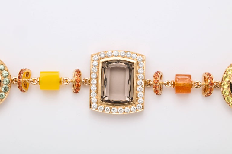 Asymmetric and artistic fancy link 18 Karat Rose Gold bracelet mounted with faceted smokey topaz: 18.96 carats, decorated with round brilliant cut diamonds: 0.91 carats; green sapphires: 1.18 carats; orange sapphires: 1.64 carats; yellow sapphires: