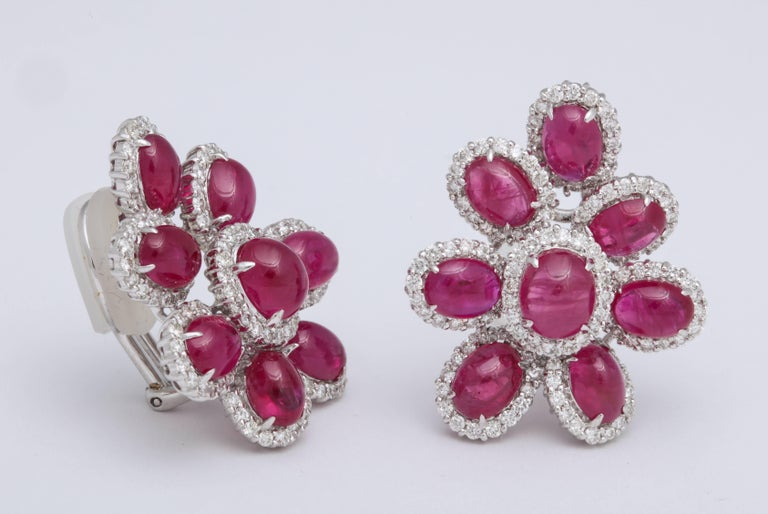 18KT white gold free form cluster of cabochon rubies: 18.99 carats, each ruby is surrounded by prong-set round brilliant cut diamonds: 2.76 carats