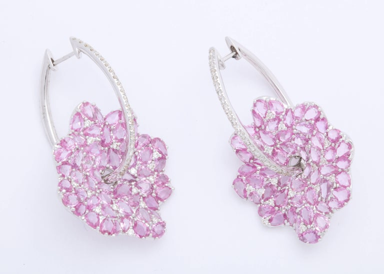Stylized leaf mounted with prong-set, fancy shape, rose-cut, pink sapphires: 13.53 carats suspended from oval hoops decorated with colorless round brilliant-cut diamonds 1.02 carats