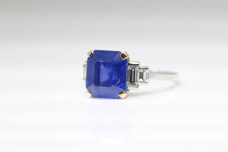 A Bulgari ring mounted with cornflower blue octagon sapphire weighing 6.54 carats, certified by SSEF. The central stone has baguette diamond shoulders leading to a slender shank.  The sapphire is natural and the origin is Sri Lankan.  The ring size