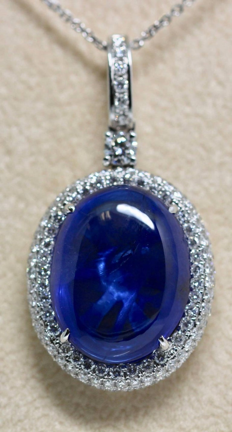 A Certified Natural Blue Ceylon sapphire and diamond pendent on 18ct  white gold chain. This Natural Sri Lankan cabochon sapphire is certified by The Gem Certification services of London. It weighs approximately 16 carats. It is set in 18ct White