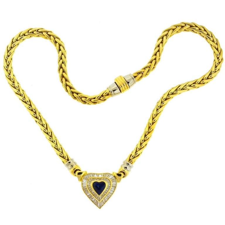 Baguette Cut 18 Karat Yellow Gold Heart Sapphire and Baguette Diamonds Pendant Necklace For Sale
