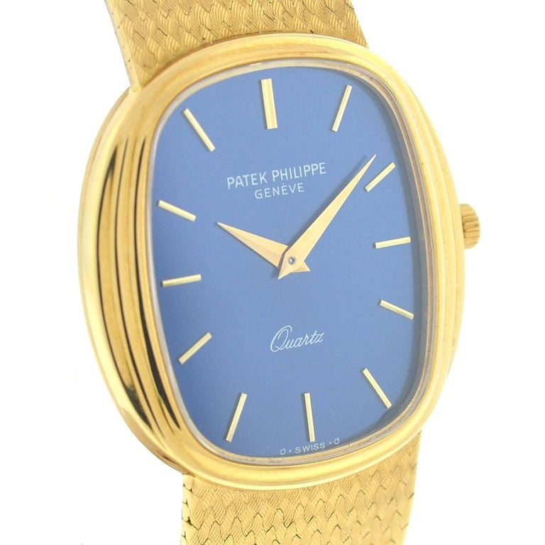 Style - Dress  Model - 3857 Weight - 94.7 Grams Case Metal - 18k Yellow Gold Case Measurement - 30 mm x 32 mm Bracelet - 18k Yellow Gold Dial - Blue Bezel - 18k Yellow Gold Bracelet Size - Fits a 6.5