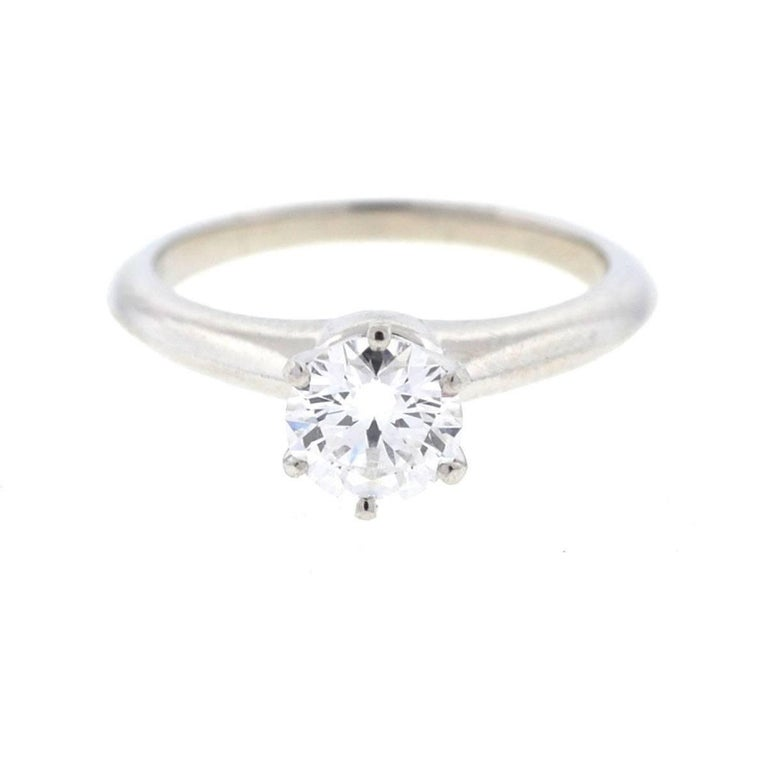 Company - Tiffany & Co. Style - Solitaire Engagement Ring  Metal - Platinum Size - 6.5 Weight - 5.8 grams Stones - Diamonds ( .89ct RB, D / VS1)  i-1195rmee