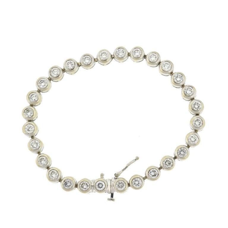 14 Karat White Gold Bezel Set Diamond Tennis Bracelet In Excellent Condition For Sale In Boca Raton, FL
