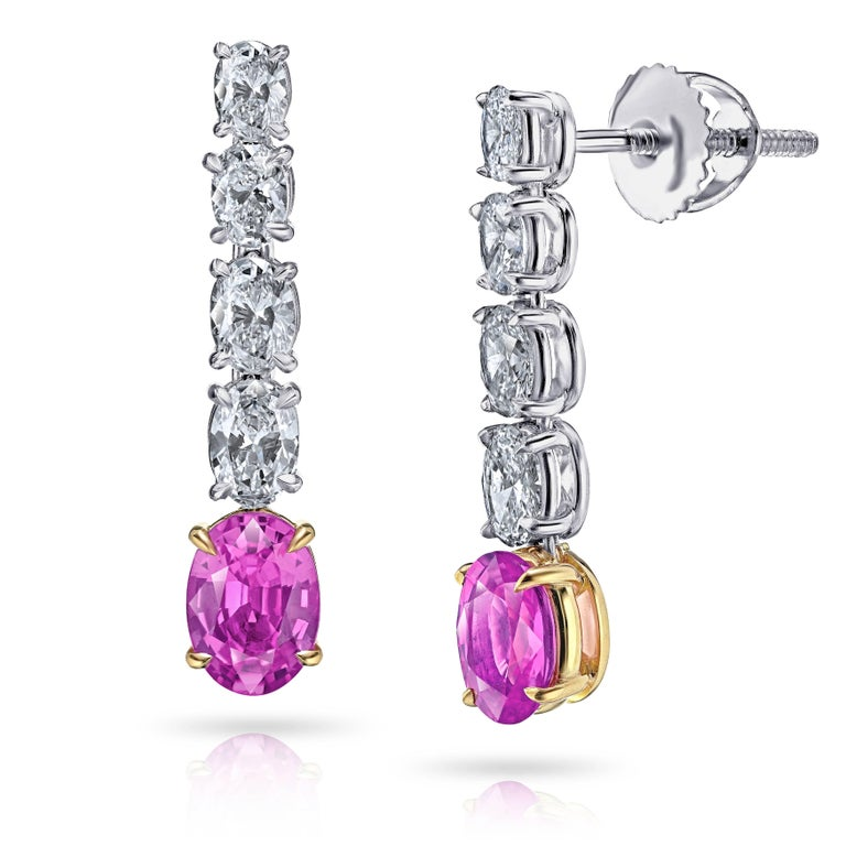 Two oval pink sapphires (natural no heat) weighing 1.73 carats set with eight oval diamonds weighing 1.25 carats (F+ VVS/VS+). Set in hand made platinum and 18k yellow gold screw back earrings. Only the finest quality stones and workmanship was used