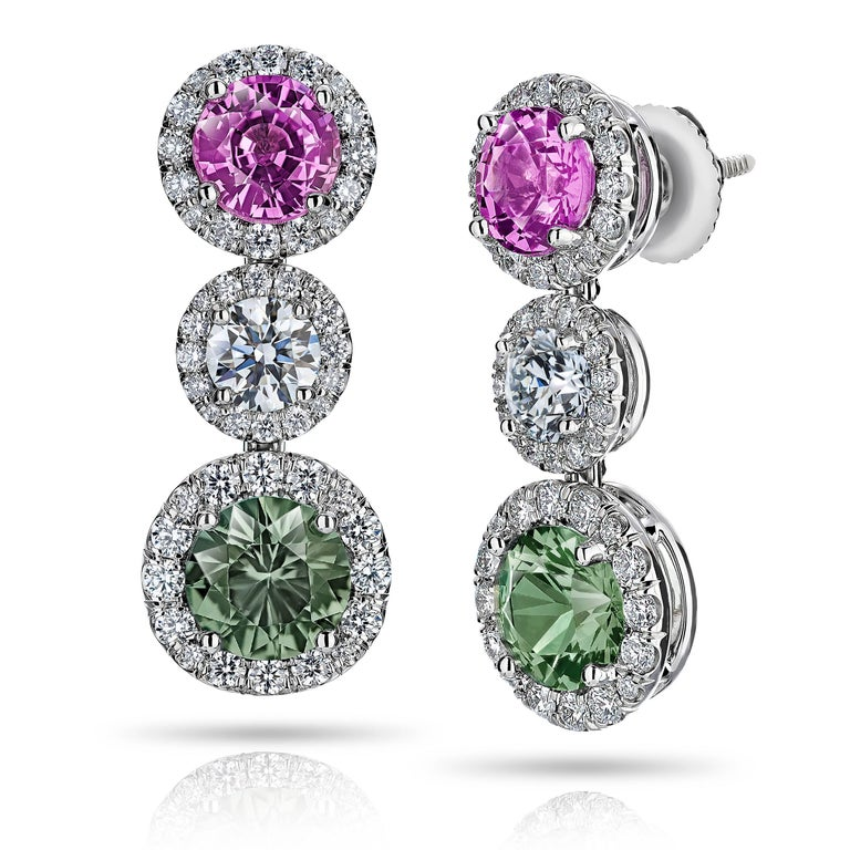 Green and Pink Sapphire and Diamond Drop Earrings, with a total green sapphire weight of 2.35 carats and 1.98 carats of the pink sapphires plus 2 round Diamonds .67 carats (GIA E /VS)  and 96 brilliant cut diamonds weighing .93 carats set in