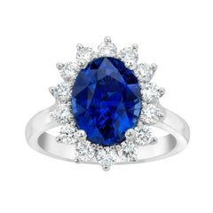 5.55 Carat Oval Blue Sapphire and Diamond Platinum Ring