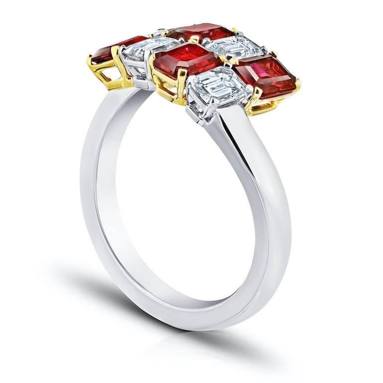 Four Natural No Heat Emerald Cut Rubies weighing 1.81 carats and four emerald cut diamonds (D-F/ VVS)  weighing 1.07 carats.  Set in a hand made platinum and 18k yellow gold ring.