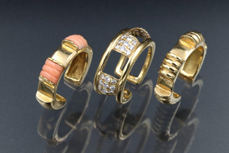 3 exchangeable rings of 18K gold diamonds and coral by Maison Boucheron. Signed The total weight is 20.3 grams The size is 51 (5.5 US) not sizeable