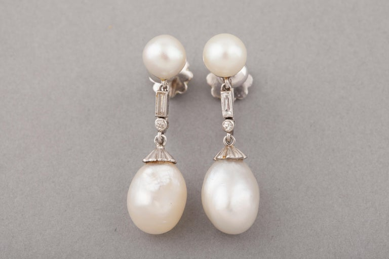 Beautiful antique pair of earrings, made in France circa 1910.  French marks for platinum. Platinum and High quality natural pearls, certified. Dimensions of the pearls/ 10 mm * 9mm  11 mm * 9 mm 7 mm * 7mm 7 mm * 7 mm   Dimensions of the earrings :