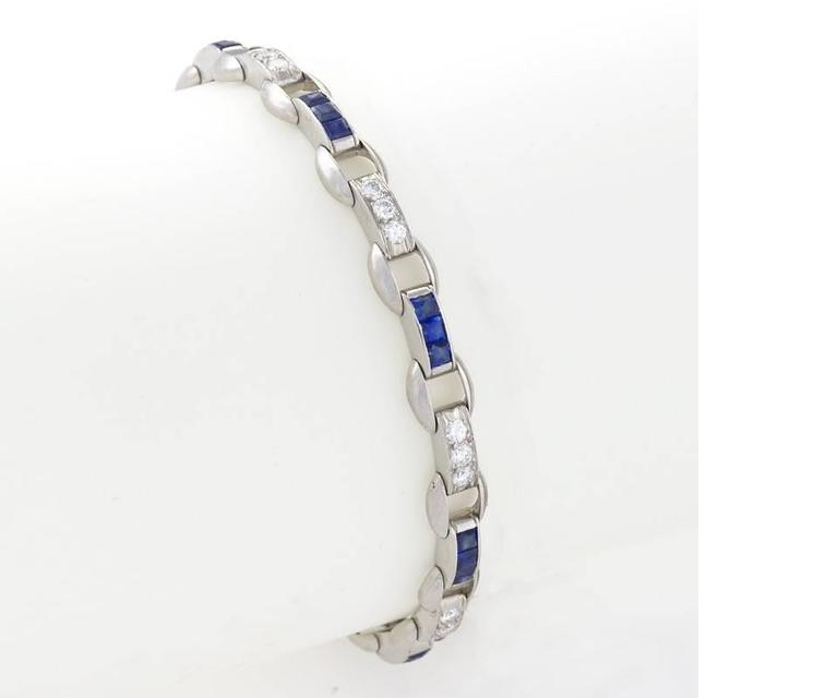 An American Estate platinum bracelet with diamonds and sapphires attributed to Oscar Heyman. The diamond  and sapphire bracelet has 24 round-cut diamonds with an approximate total weight of 1.20 carats and 24 calibre-cut sapphires with an