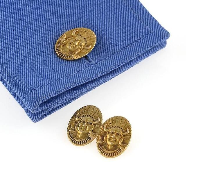 "A pair of American Antique 14 karat gold double sided cuff links. The double sided cuff links portray an American Indian chief in deeply modeled relief.   Double sided. Circa 1900.  Pictured in ""Cuff Links"", by Susan Jonas and Marilyn Nissenson,"