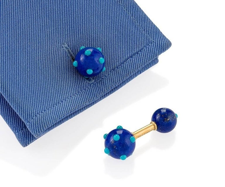 A pair of French Mid-20th Century 18 karat gold cuff links with lapis lazuli and turquoise by Jean Schlumberger for Tiffiany & Co.. The cuff links have a total of 22 cabochon turquoise stones set into the 4 lapis lazuli balls. Circa 1960's.  Similar