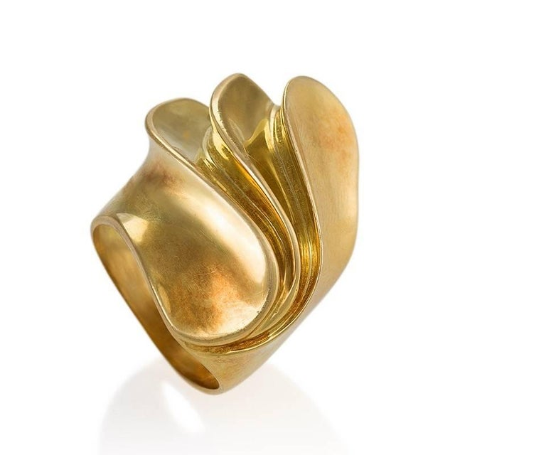 A French 18 karat gold ring. The ring is designed in a Modernist, dimensional swirl motif.  Circa 1970's.  Signed, French control mark.   Ring size 8; this ring can be sized.  (MG #18223)