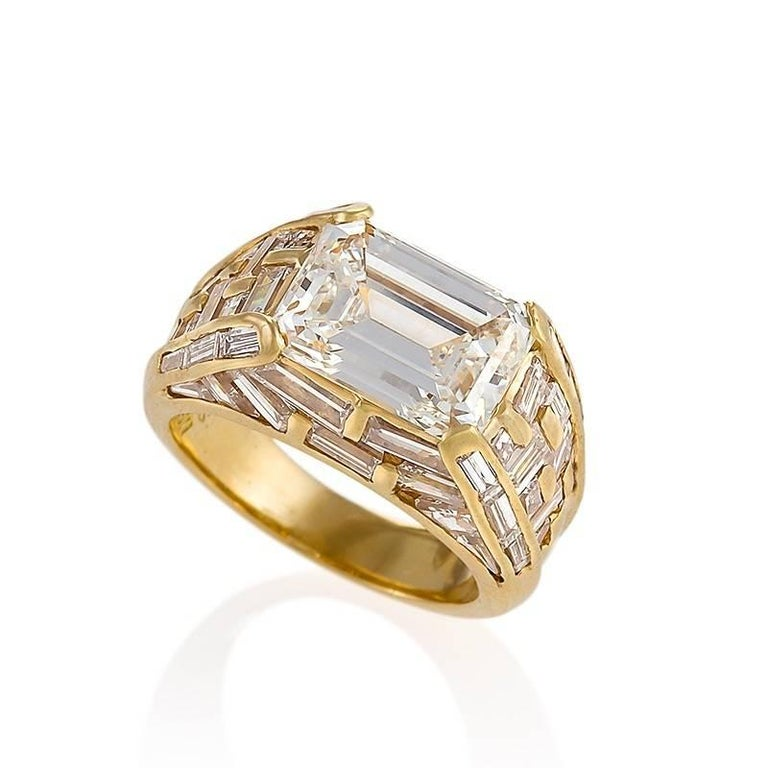 An Italian Estate 18 karat gold ring with diamonds by Bulgari. This ring centers on an emerald-cut diamond, 4.01 carats, H color, VS-2 clarity. The architectural setting has 50 baguette-cut diamonds with an approximate total weight of 2.80 carats.