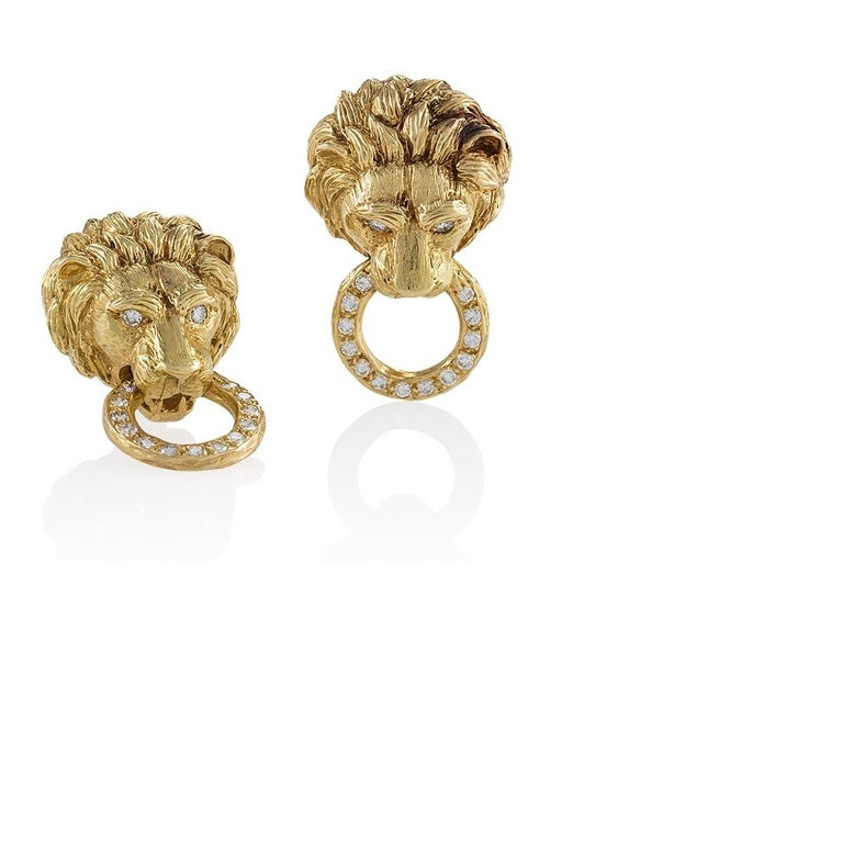 A Pair Of Mid 20th Century 18 Karat Gold Lion Head Earrings With Diamonds By