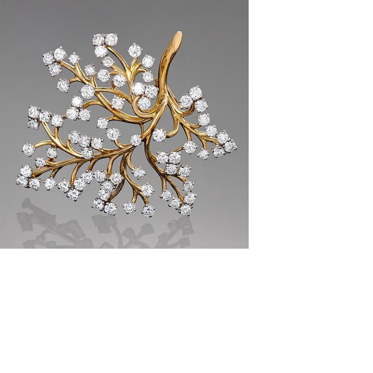A French Mid-20th Century 18 karat gold 'Capillaire' brooch with diamonds by Van Cleef & Arpels. The brooch has 74 round diamonds with an approximate total weight of 6.00 carats, E/F/G color, VS clarity.  Circa 1959.  A similar brooch is pictured in