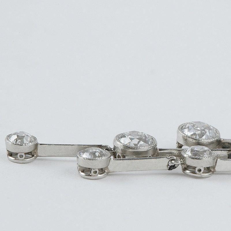 Women's 1920s Art Deco Onyx Diamond Platinum Brooch For Sale