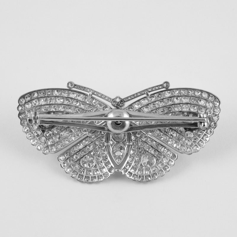 An Art Deco platinum brooch with diamonds. The brooch has  6 old European-cut diamonds with an approximate total weight of 1.20 carats, 1 old European-cut diamond with an approximate total weight of .50 carats, 236 single-cut diamonds with an