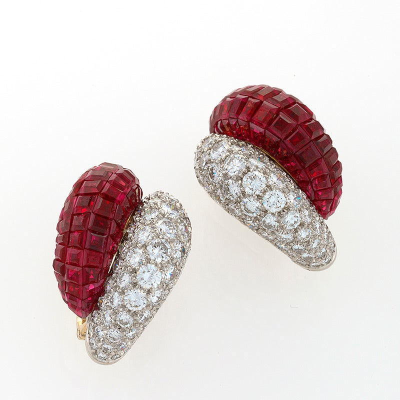 "A pair of French Mid-20th Century 18 karat gold and platinum earrings with diamonds and rubies by Van Cleef & Arpels. These ""Boule"" earrings have 136 round-cut diamonds with an approximate total weight of 8.50 carats, G/H color, VS clarity, and 186"