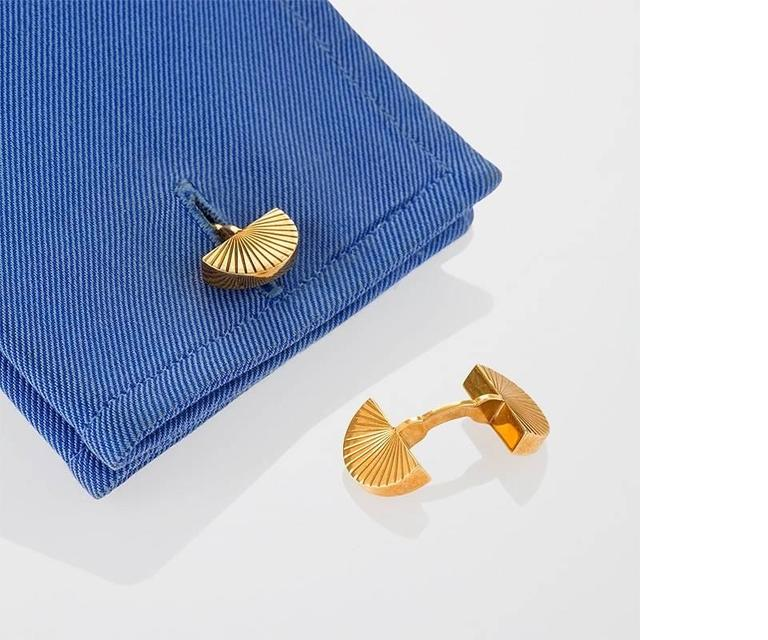 """A pair of French Mid-20th Century 18 karat gold cuff links by Cartier. The double sided cuff links are composed in a dimensional half-moon fan motif. Circa 1960's.   Signed, """"Cartier Paris"""" """"010470"""" French control and house mark.    (MG #17128)"""
