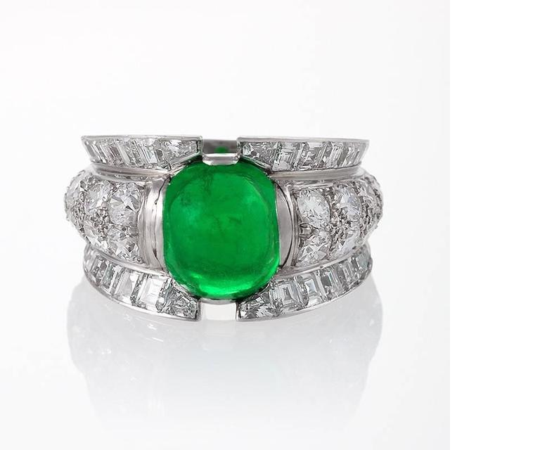 A French Late-20th Century 18 karat gold and platinum ring with emerald and diamonds. The ring has 18 round diamonds with an approximate total weight of 1.55 carats, 32 square-cut diamonds with an approximate total weight of 1.75 carats, and a