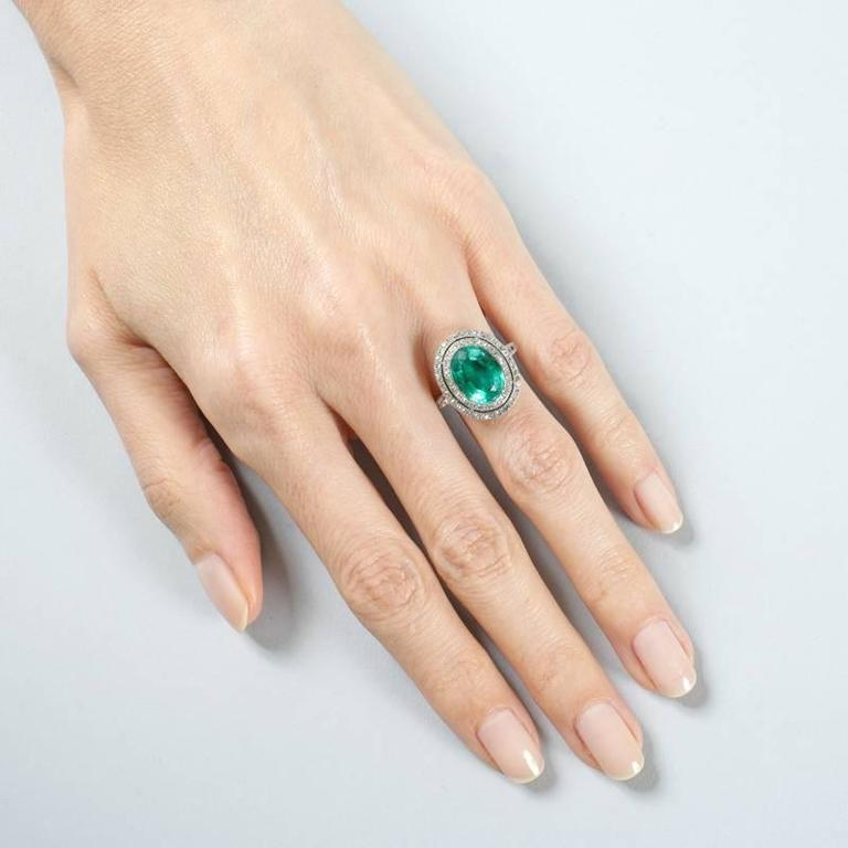 Oval Cut Colombian Emerald and Diamond Halo Ring  For Sale