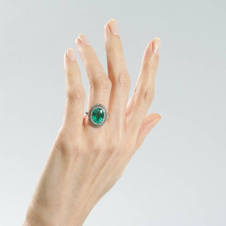 Colombian Emerald and Diamond Halo Ring  In Excellent Condition For Sale In New York, NY