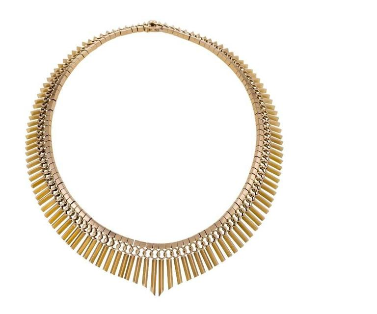 """A European Mid-20th Century 18 karat gold necklace. The necklace is composed of graduated and articulated fringe which hangs from overlapping rings and a box link chain.  Circa 1950's.   Signed, """"18k"""" """"750"""".   (MG #16828)"""